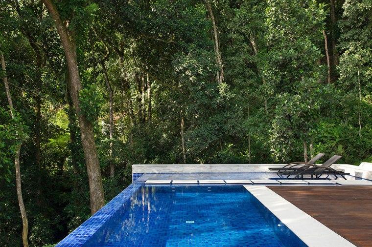 casa-portobello-13-vista-piscina-mata-verde-azul-hidromassagem-borda-infinita-externa-lateral-tripper-arquitetura