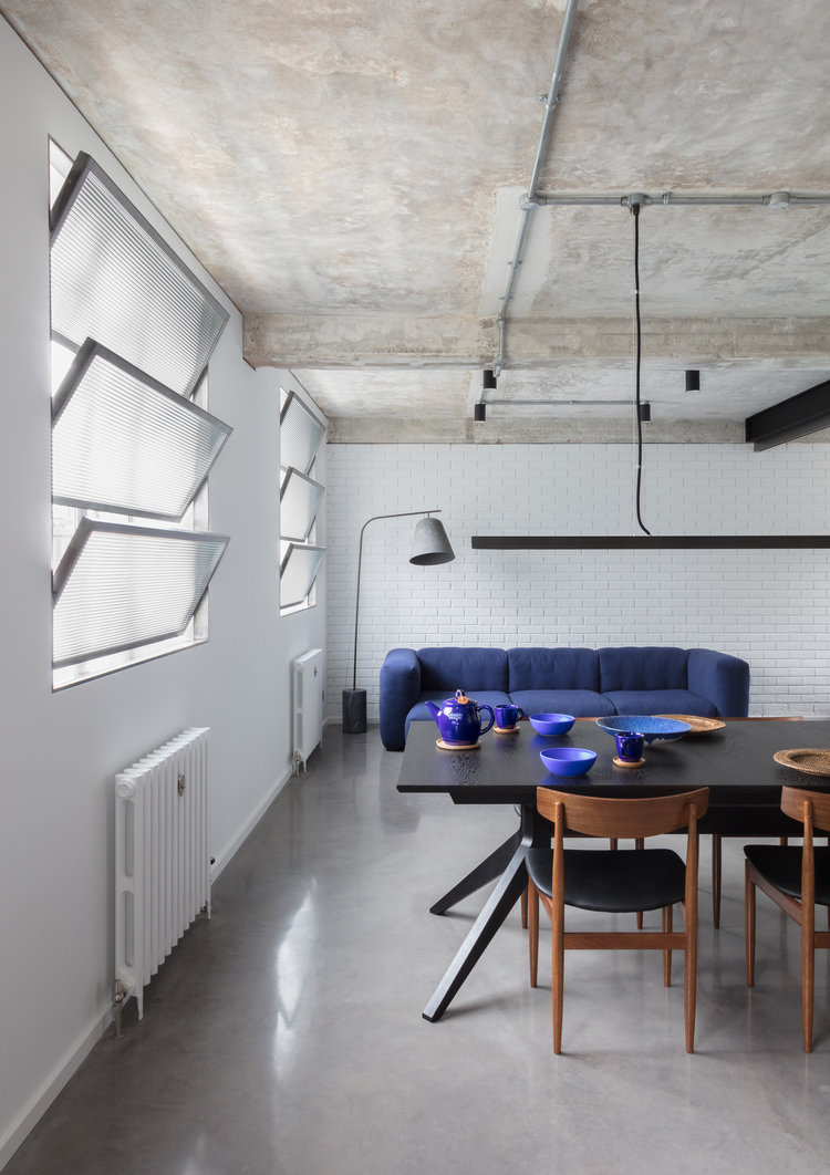 Union-Wharf-Islington-London-Exposed-Concrete-Ceiling-Shutters-Dining-Hay-Sofa-Interior