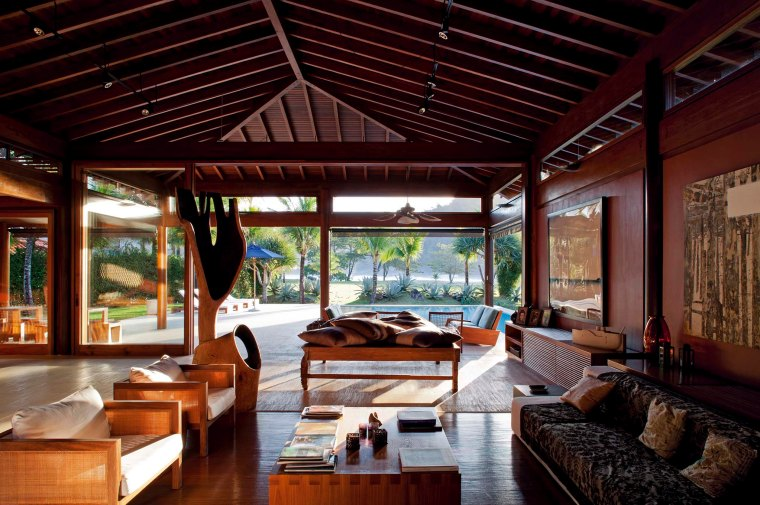 Living room in the foreground and veranda in the background
